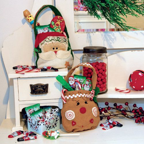 styled shot of santa and rudolph christmas appliqu and embroidered bags with treats