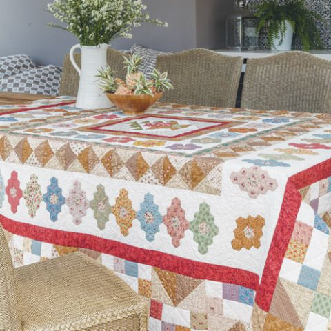 Styled shot of english paper pieced patchwork quilt on table