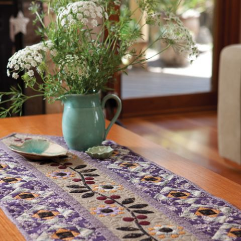 Styled shot of purple floral table runner
