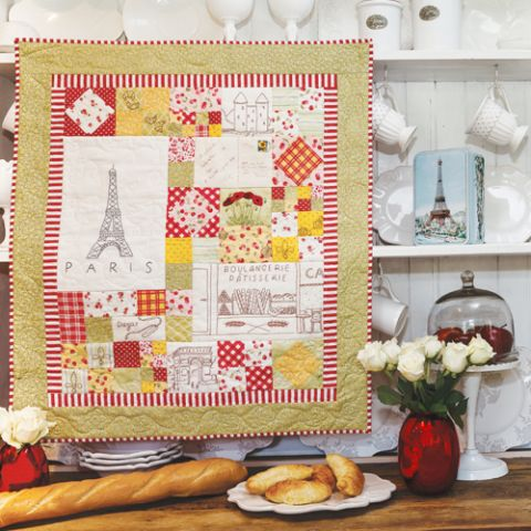 Styled shot of french themed wallhanging quilt