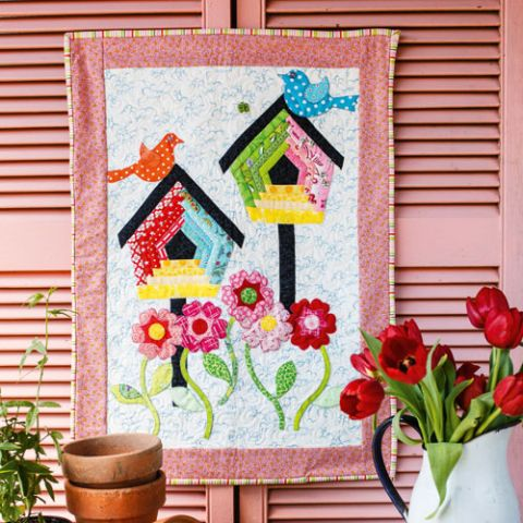 styled shot of flying colours bird wallhanging