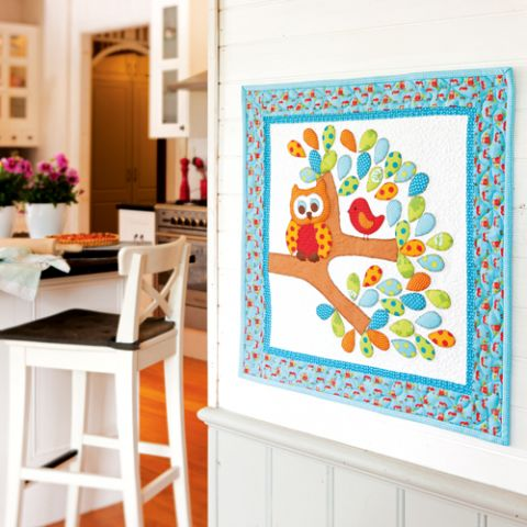 Styled shot of owl wallhanging applique quilt in kitchen area