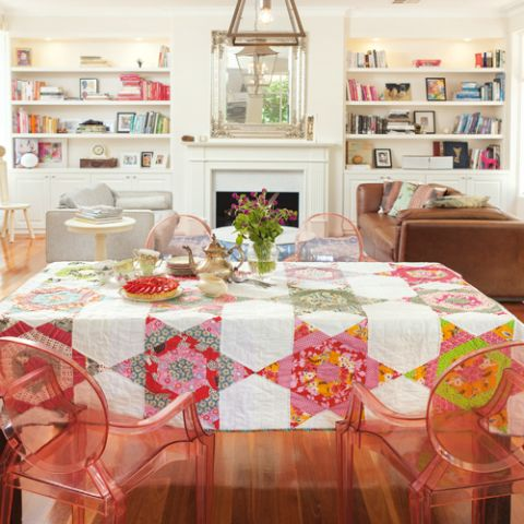 Styled shot of colourful star patterned quilt on table with tea and cake