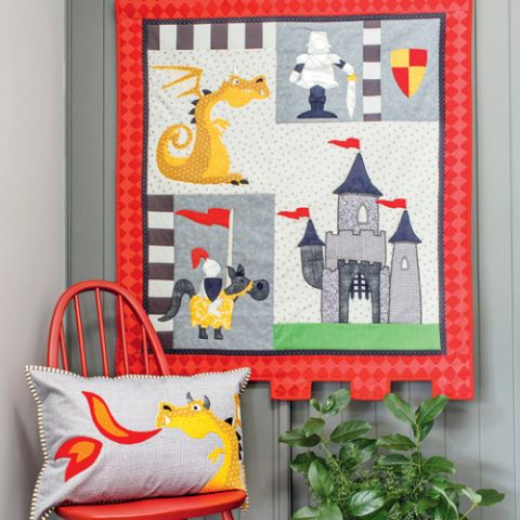 Knights, dragons and castle appliqué wallhanging quilt and cushion styled shot hanging up on wall