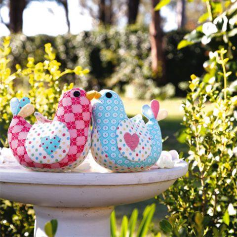 Styled shot of bird softies in bird bath outdoors