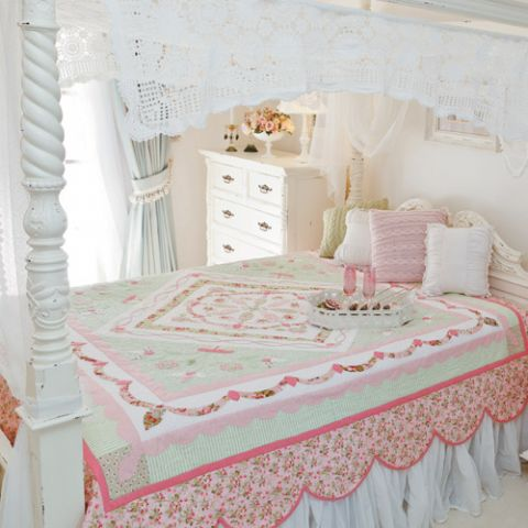 Styled shot of traditional-style appliqué medallion quilt on bed