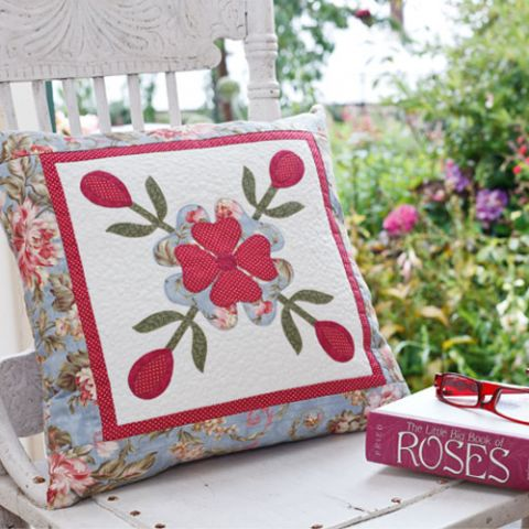 styled shot of rambling rose cushion