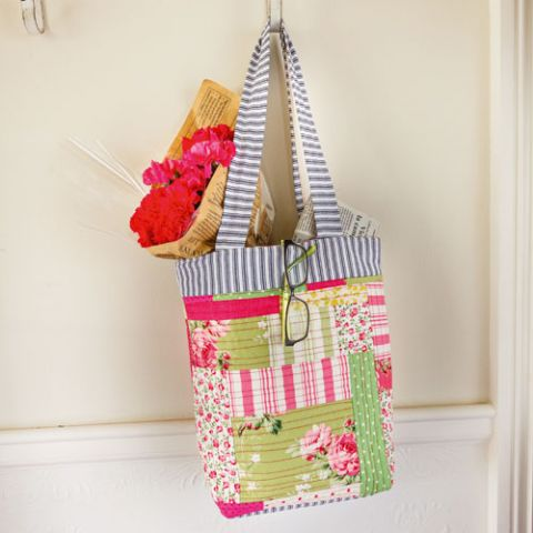 styled shot of smell the roses patchwork tote bag