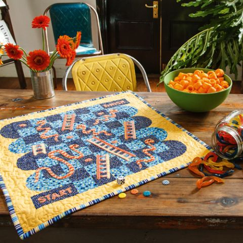 Styled shot of snakes and ladders boardgame quilt