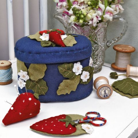 styled shot of strawberry fare sewing accessories
